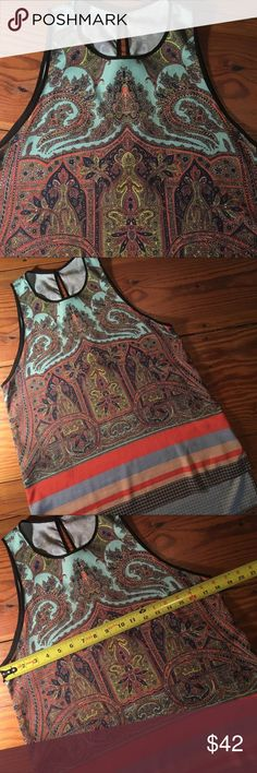 Clover Canyon Top Exceptional Clover Canyon top with beautiful paisley patterns and amazing colors! Always draws lots of compliments. High low hemline with bold stripes on the bottom. Really nice Clover Canyon piece. Clover Canyon Tops Blouses