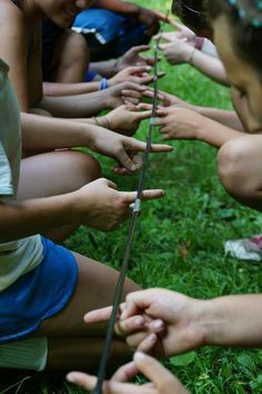 Tent Pole Game Team Building Activities. Great Activity to do with older kids. Everyone in the group has to keep 2 fingers on the tent pole at all times. The goal is to bring the pole off the ground to a certain height without anyone taking their fingers off the pole. (Could go from a certain height then to the ground.) If someone's finger comes off, the group must re-start.