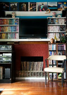 storing records in unused fireplace. | via Apartment Therapy