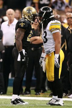 Troy Polamalu of the Pittsburgh Steelers engaging in a little trash talk with this New Orleans Saints player.