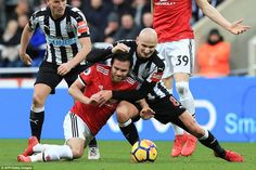 Juan Mata goes down under the challenge of Shelvey, who was instrumental in helping his side to victory at St James' Park