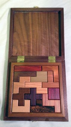 Pentominoes Wooden Puzzle by finkh on Etsy Tangram Puzzles, Wooden Puzzles, Woodworking Toys, Woodworking Projects, Difficult Puzzles, Wood Games, Wooden Art, Business Gifts, Wood Toys