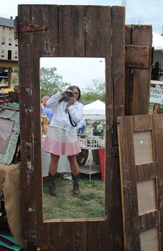 I could make a door from old fence boards (I have a bunch) and hang a mirror on it! Look at the hardware, too!via Country Living Magazine