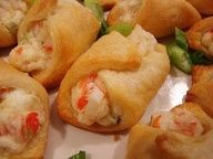 Crab  Cream Cheese Crescent Rolls...super easy appetizer! 1-8 oz. tube crescent roll dough 3 oz. cream cheese, softened 1/4 cup mayonnaise 3/4 cup cooked crabmeat, chopped 2 green onions, chopped 1/8- 1/4 teaspoon cayenne pepper salt and pepper, to taste Heat oven to 375F. Spray cookie sheet with cooking spray. Unroll dough on wo