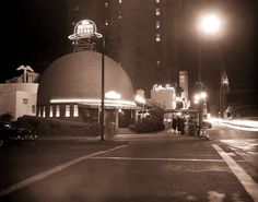 This sepia-tinged photo of the original Brown Derby on Wilshire Blvd, cross the street from the Ambassador Hotel is from 1957 and is now one of my new most favorite photos of one of my most favorite places of Hollywood's yesteryear. I feel like I want to slink in at 2am, order a jumbo plate of chili fries, a chocolate thick shake, and a slice o' pie.