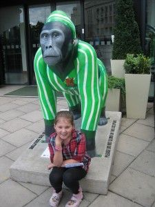 """There are some cities with funny activities. Bristol has many brightly coloured houses high above the docks and a colourful """"gorilla hunt""""  - here is the gorilla wearing his lime green pyjamas. Both Bristol and Congelton are English town that I have visited."""