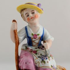 Sitzendorf Germany Porcelain Figurine of Seated Girl with Rake from Antik Avenue on Ruby Lane #Sitzendorf #figurine #Germany www.rubylane.com/shop/antikavenue