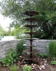A water feature made from an old disk  plough...from the Owner Builder Network.