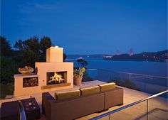 love the outdoor fireplace with deck and view