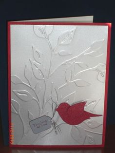 handmade card ... mat metallic silver paper and red ... embossing folder branches with leaves ... red two step punched bird ... elegant look ... l