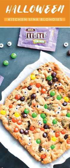 Customize your favorite dessert for the fall season with the help of candy from Kroger—like M&M's and Twix! This recipe for Halloween Kitchen Sink Blondies is everything you need to get ready for this spooky holiday in the tastiest way. Plus, with Halloween tablescape inspiration, you'll be ready for party guests in no time!