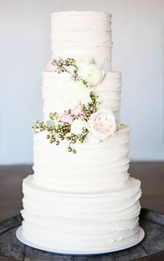 Wedding cake, I love the simplicity of this. Yet, it is elegant.   With the Willow Tree Topper that would be perfect!
