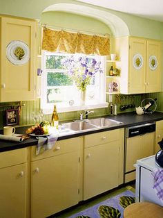 My Kitchen is black I think I may want to paint the cabinets yellow to brighten the kitchen up