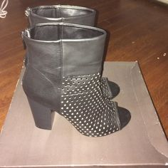 Black perforated bootie Black faux leather bootie with perforated upper and black heel Shoes Heels