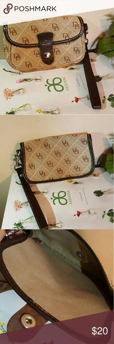 """Authentic Dooney and Bourke wristlet Vintage?? Dooney and Bourke wristlet in excellent condition.   Not sure what you classify as """"vintage"""" but I was given this wristlet over 12.years ago.  Barely used and has been put away in storage for years. Dooney & Bourke Bags Clutches & Wristlets"""