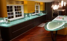 Love the glass counters here... reminds me of the ocean. I REALLY dislike the yellow cabinets but I could change those out.. lol