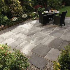 Simple, large concrete squares & rectangles in slightly varying shades for a patio~ EASY & lovely!