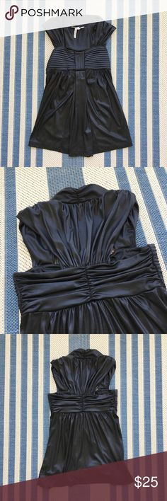 BCBGeneration black shiny top. BCBG Generation XS top. Only worn a couple times, excellent condition. MEASURED FLAT: Armpit to armpit: 13.5 inches Top to bottom: 26 inches BCBGeneration Tops Blouses