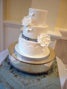 Nautical stripe wedding cake. Love the lace and nautical touch! It will tie in my wedding dress and theme!! Perfect!