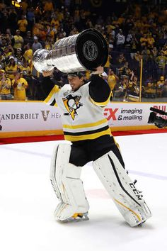 NASHVILLE, TN - JUNE 11: Marc-Andre Fleury of the Pittsburgh Penguins celebrates with the Stanley Cup Trophy after defeating the Nashville Predators 2-0 to win the 2017 NHL Stanley Cup Final at the Bridgestone Arena on June 11, 2017 in Nashville, Tennessee. (Photo by Bruce Bennett/Getty Images)
