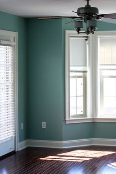 living room ideas: teal green with white trim