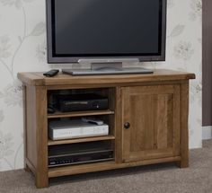 Solid American White oak Tongue & Groove Backs and Bases 2 Adjustable Central Shelves 2 Outer Cupboards Round Black Metal Knobs Cable Holes At The Back Medium Lacquer Finish Delivered Fully Assembled