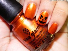 Jack o lantern Halloween Cross Iron (China Glaze)Retail Price: $6.50  Use a small dotting tool or a toothpick to draw on the black details for a jack-o-lantern.