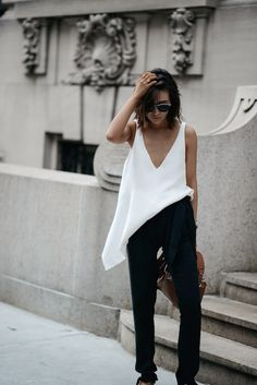 Le Fashion Blog Blogger Style Black Harem Pants Assymetrical White Top Pointed Shoes Via Z Hours Más