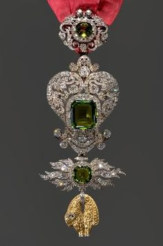 Jewelled medallion (1870 to 1890) of the Order of the Golden Fleece - an order of chivalry founded by Philip III, Duke of Burgundy in 1430, to celebrate his marriage to the Portuguese princess Infanta Isabella of Portugal, and the extension of his Habsburg territories across Europe.