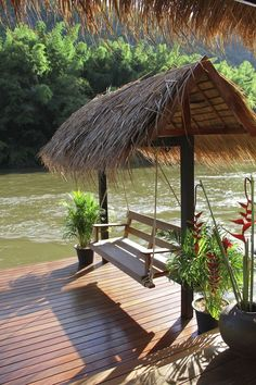 love this! lakeside arbor swing. tiki hut inspired.
