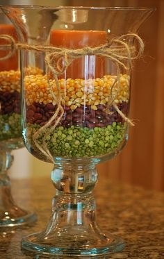 Split peas, red beans and corn kernals with a candle in and apothecary jar. Perfect centerpiece for fall!!