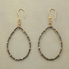 Nuggets of oxidized sterling silver and gold vermeil create dramatic contrast on graceful teardrop hoops