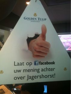 Dutch hotel has sign above reception with the request to leave a review on its Facebook page. Connecting online and offline