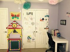 My desk and our art wall with our puppet theater