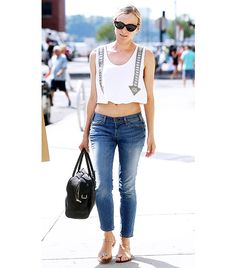 Diane Kruger's street style: skinny blue jeans, white crop top, flats, sunnies and black tote. Get The Look: ASTR Beaded Lace Crop Top ($52); AG Stevie Ankle Jeans ($168); MEL Pepper Post Flip Flop ($35).