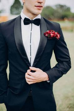 Floral Pocket Squares for the Groom ~ these tiny red blooms against the black jacket makes the pocket square pop! By Flower Talk