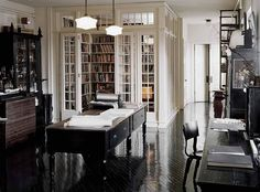 Enclosed library in the lower Manhattan loft of design duo Robin Standefer and Stephen Alesch (of Roman and Williams Buildings and Interiors) #books #bookshelves #interior_design #library #loft