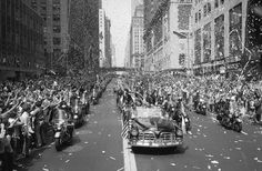 New Yorkers line 42nd Street to cheer Apollo 11 astronauts, on August 13, 1969. In the lead car from left are: Edwin Aldrin, Michael Collins and Neil Armstrong, who return the greeting with waves. (AP Photo/STF)