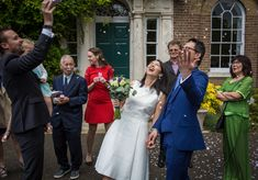 Beautiful bride and groom outside the registry office with confetti showering them.
