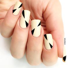Minimalist nails with black triangles