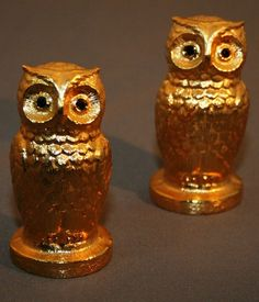 Hey, I found this really awesome Etsy listing at https://www.etsy.com/listing/69580971/vintage-gold-gilted-owl-salt-and-pepper