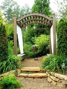 This simple arbor is filled with one-of-a-kind features. Learn them all here: http://www.bhg.com/gardening/landscaping-projects/landscape-basics/arbors-and-trellises-in-the-landscape/?socsrc=bhgpin071312simplearbor