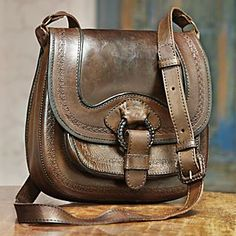 I love tooled leather bags.