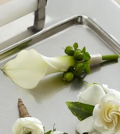 The FTD® White Calla Boutonniere is the picture of elegant sophistication. A single full-sized white calla lily is chosen for its absolute perfection and accented with green hypericum berries and a wh