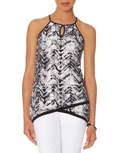 Printed Halter Top - Super stretch knit gives this edgy top ultra comfort! Pair it with faux leather skinnies and a long chain necklace for a modern all-day look.