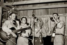 """October 1938. """"Cajun orchestra for fais-do-do near Crowley, Louisiana. Having intermission with drinks."""" View full size. Medium format nitrate negative by Russell Lee for the Farm Security Administration."""
