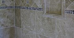 shower - travertine tile with glass tile border