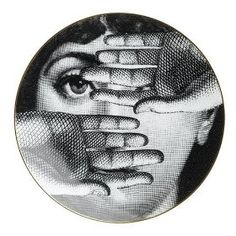 The face of Fornasetti's muse, Lina Cavalieri. He must have done hundreds of versions of this face.