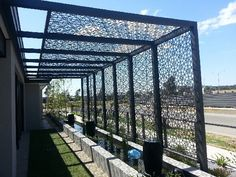 Black pergola with screen.