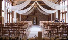 Hanging wedding drapes at Upwaltham Barns by Stressfree Hire